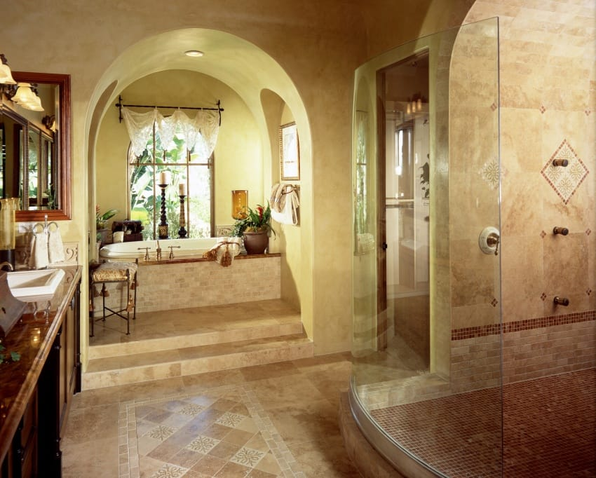 bathroom with arched ceilings