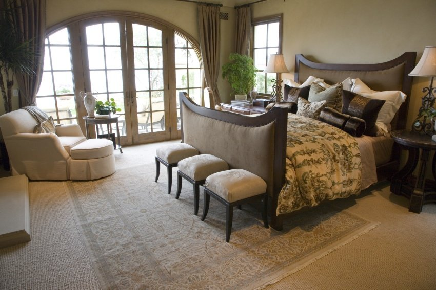 bedroom with arched French doors