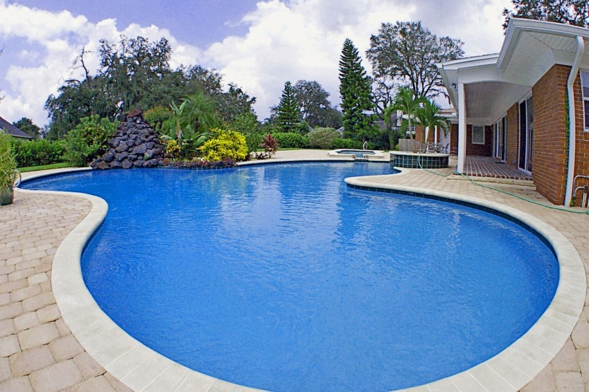 15 swimming pool ideas for backyard types and cost for Large swimming pool designs