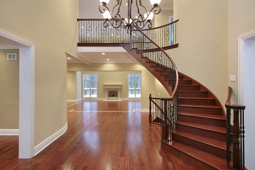 Amazing luxury foyer design ideas photos with staircases for Curved staircase design plans