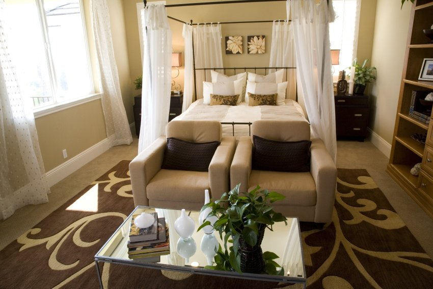 bedroom with sheer canopy drapes