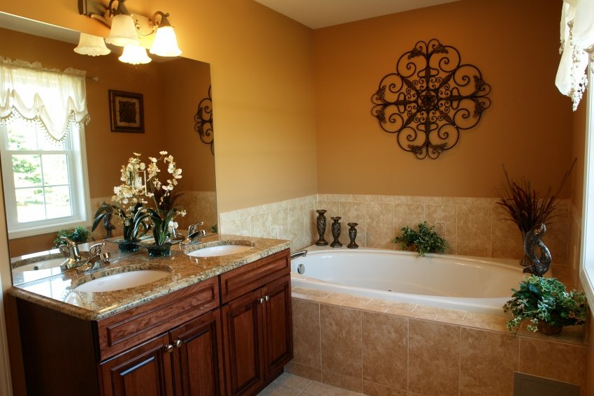 bathroom is set in beige tiles