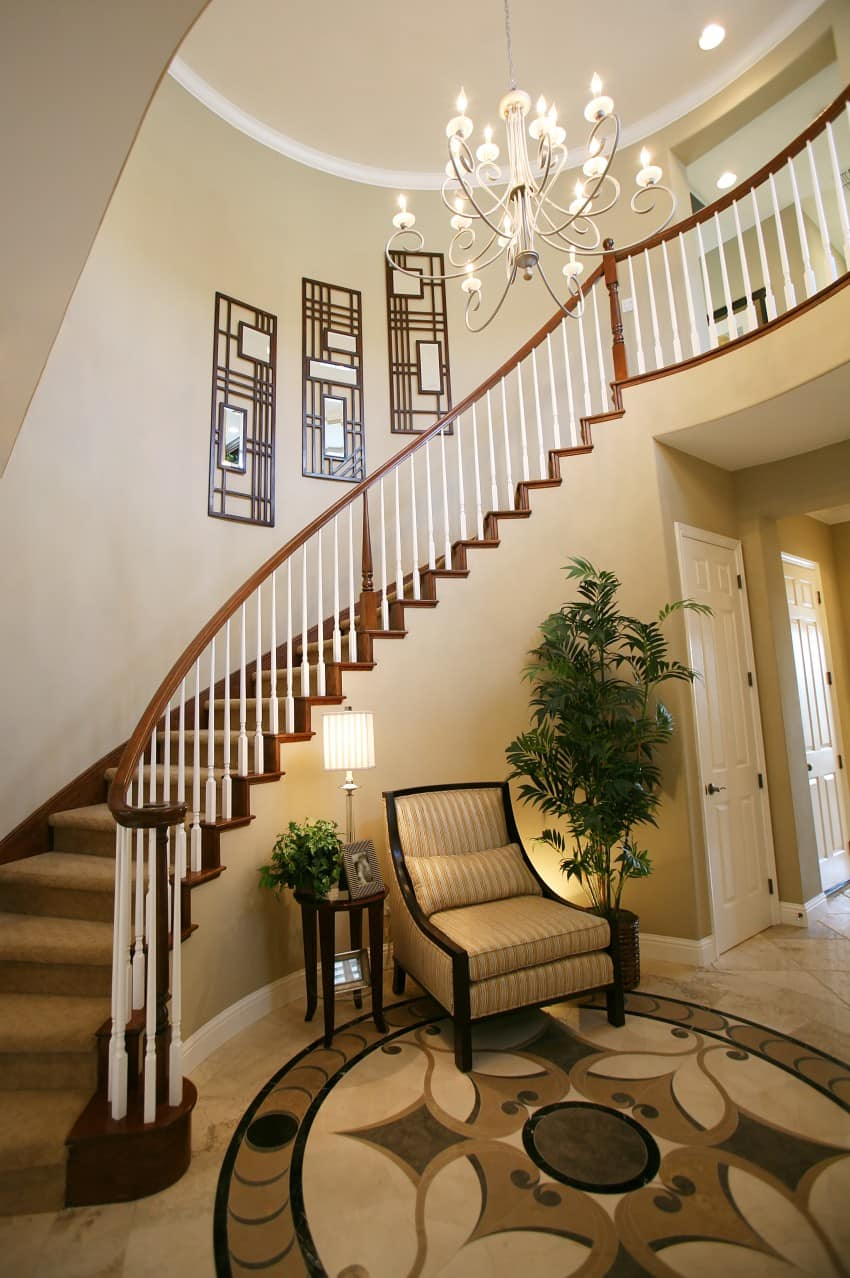 cherry wood foyer with balcony and curved staircase the color of the