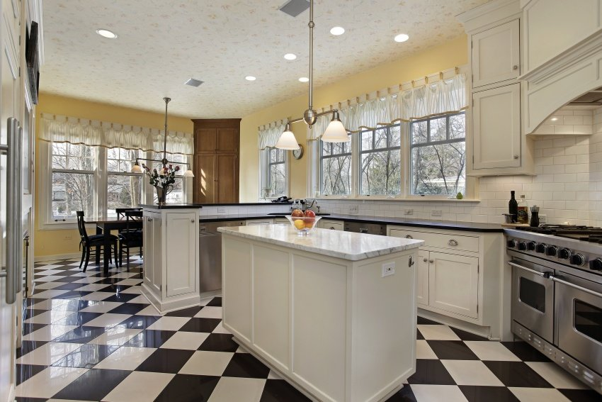 White cabinetry with black countertops