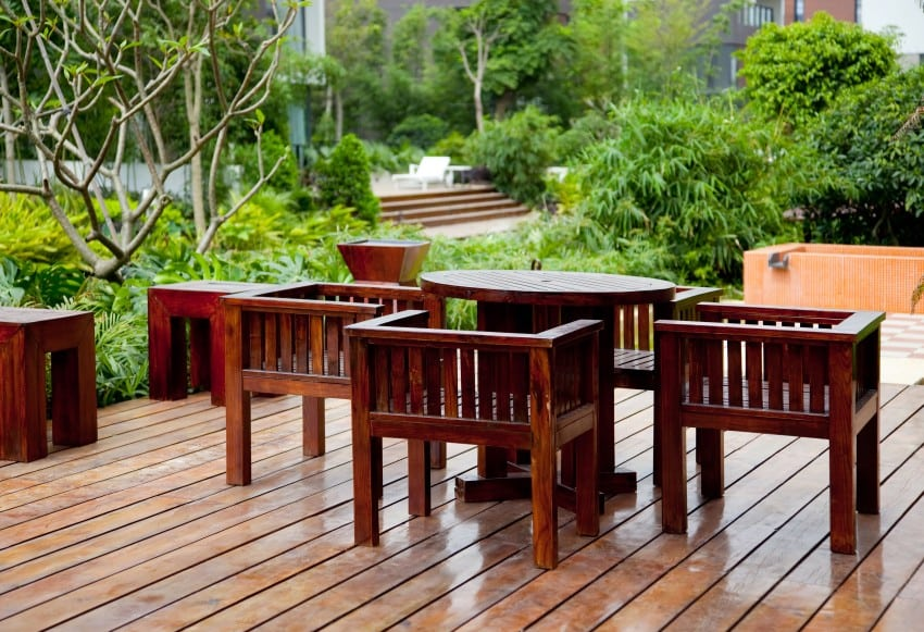 House-patio-with-wooden-table-chairs