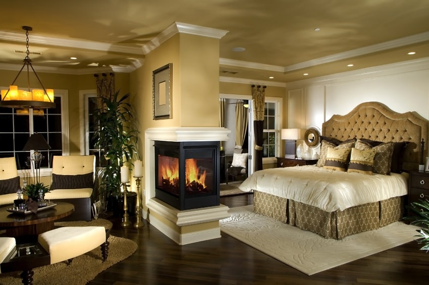 bedroom with pass-through fireplace