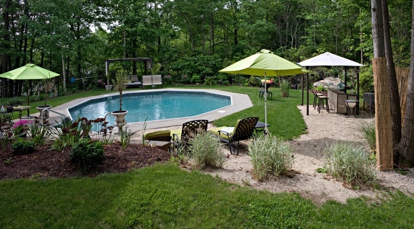 Small but luxurious in ground pool and patio this partly wooded