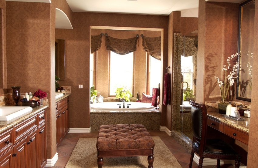 lavish bathroom set in ceramic tiles and speckled granite