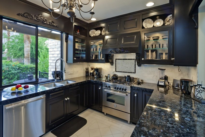 kitchen with dark wood and black granite