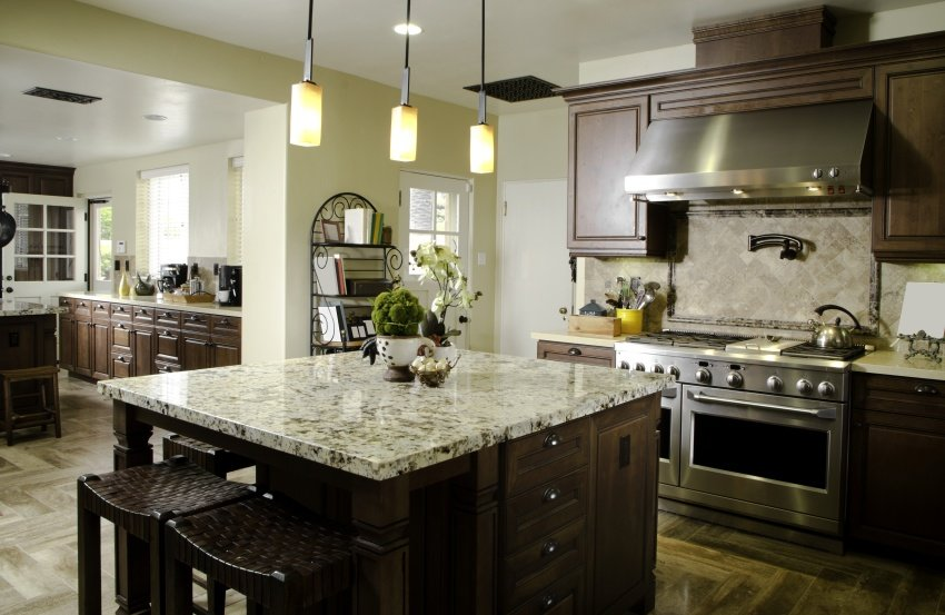 kitchen island with light pendants hang over it