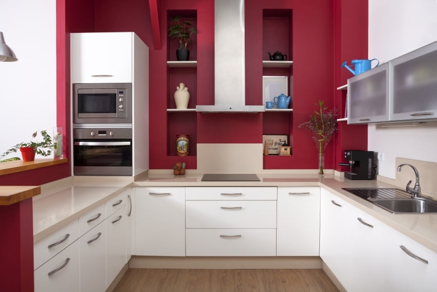 small kitchen with red walls