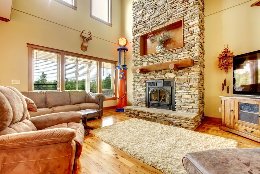 family room with stone clad fireplace