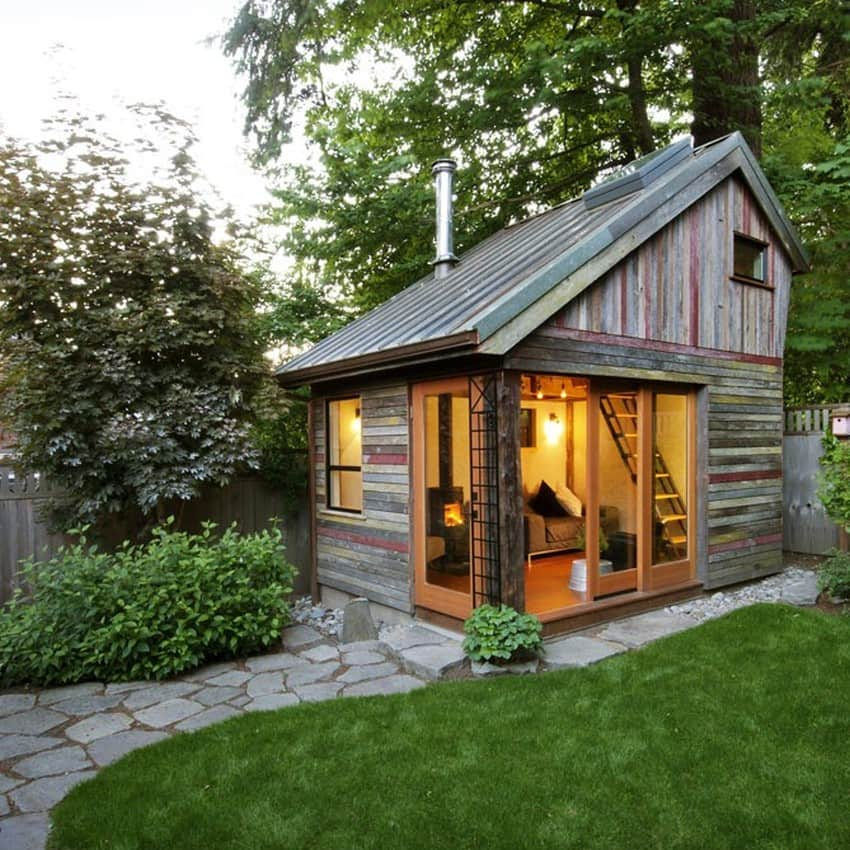 This tiny wooden house with an asymmetric gable roof can make a great addition to your backyard