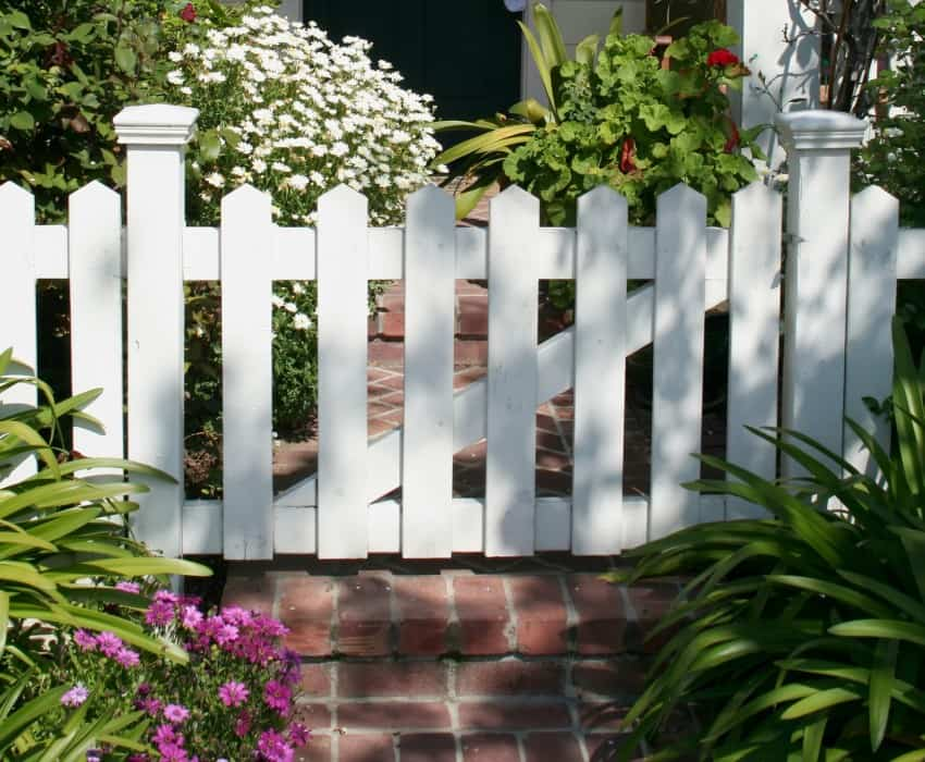 White picket fence gate in front yard