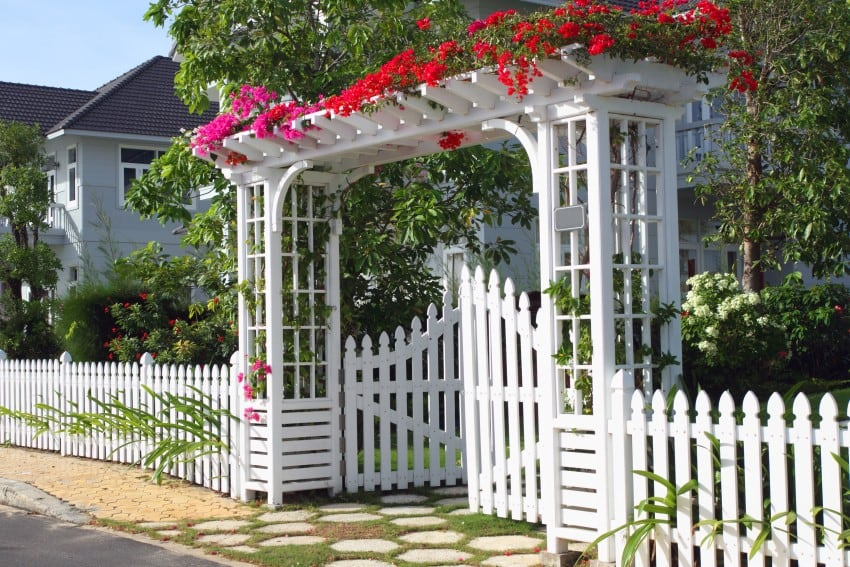 white gate and picket fence