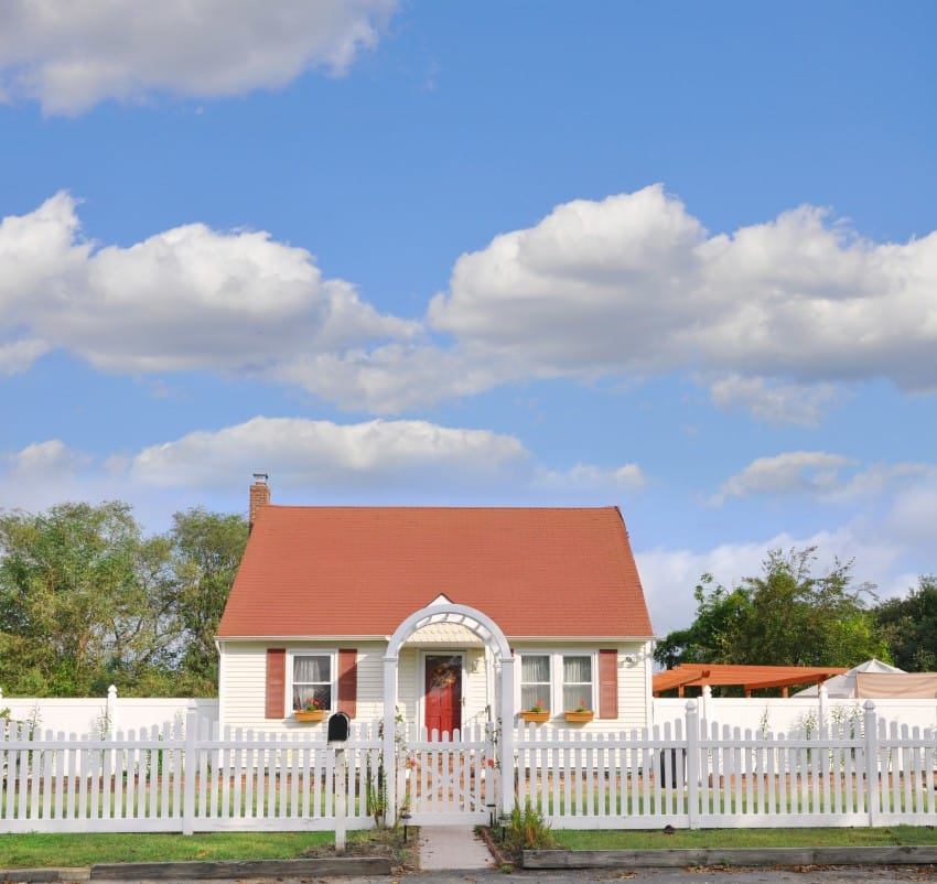 Suburban Middle Class Country Bungalow Cottage Home with White Picket Fence