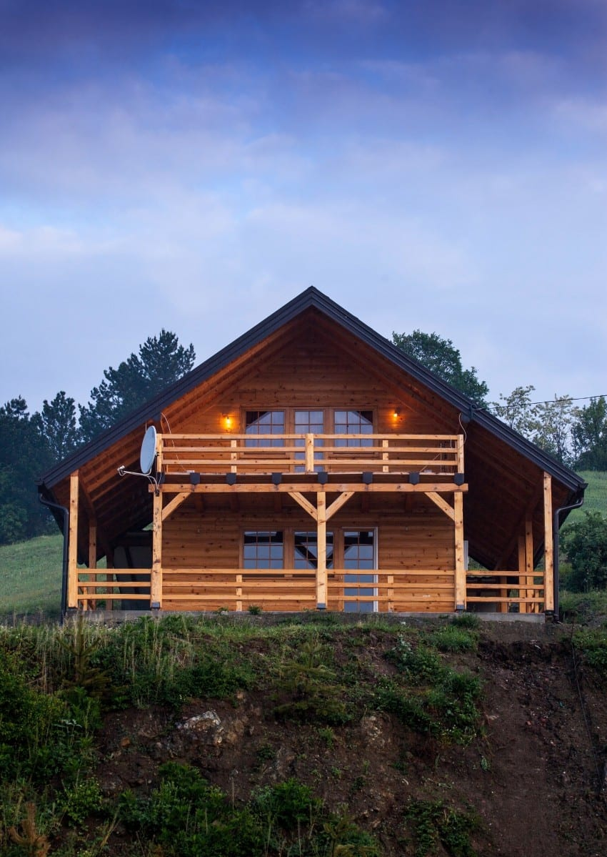 log cabin on a hill