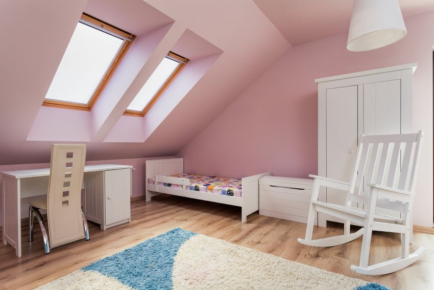 attic bedroom with walls and ceiling in delicate pink