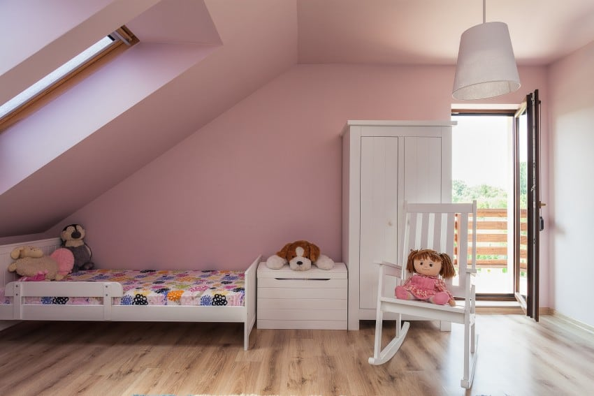 White furniture and pink walls in loft attic room