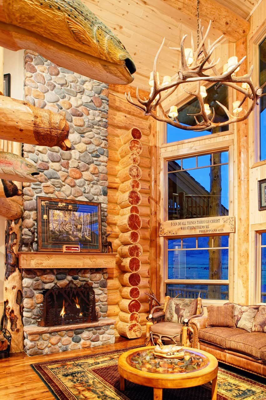 stone clad fireplace in a log room