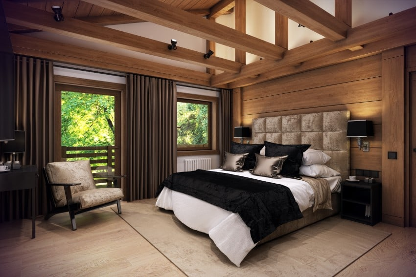 bedroom with lots of wood in loft area