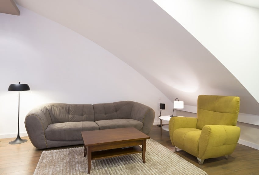 sofa, armchair and a coffee table in attic