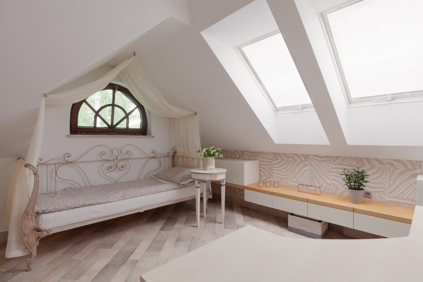 canopy bed in attic bedroom