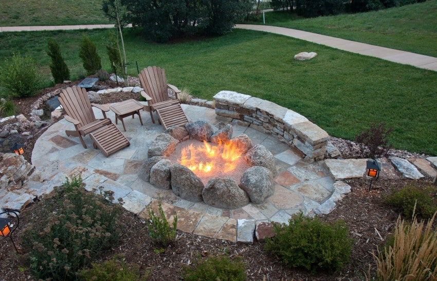 stone firepit with sitting around - Outdoor Fire Pit Design Ideas