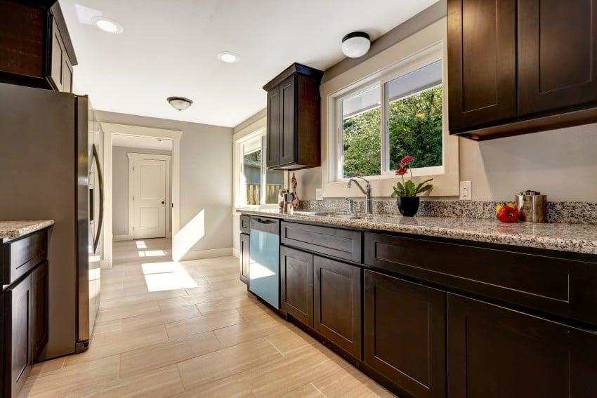 speckled granite dark wood kitchen