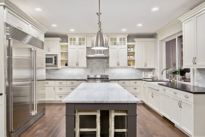 white kitchen with dark granite