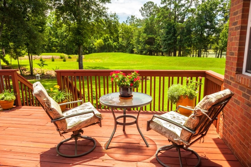 this deck is finished in red wood which goes great with the red brick exterior of the house that it is attached to wood and brick are always a nice match - Deck Design Ideas