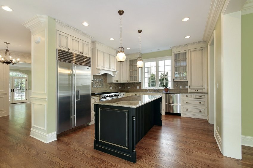 Sage And Tan Kitchen With Black Counters