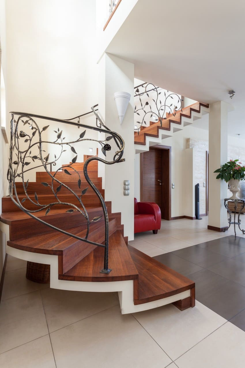 curved staircase with wooden steps