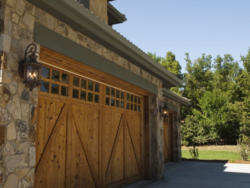 wood and stone house garage exterior