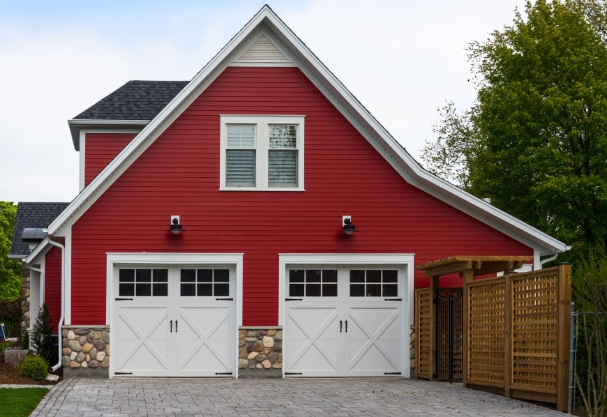 red house with white garage doors