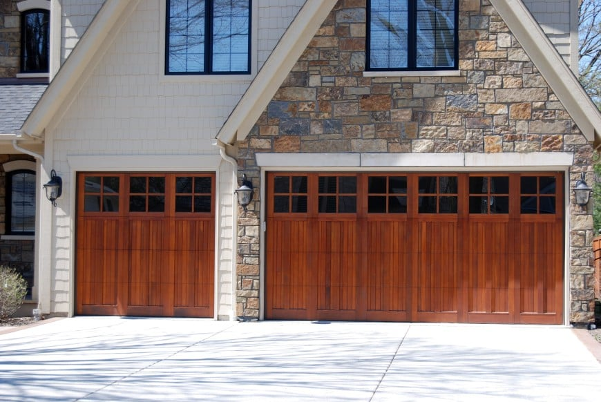 3-car garage with wood doors