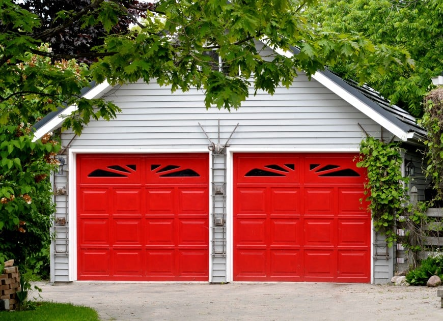 two-car steal garage with red color doors