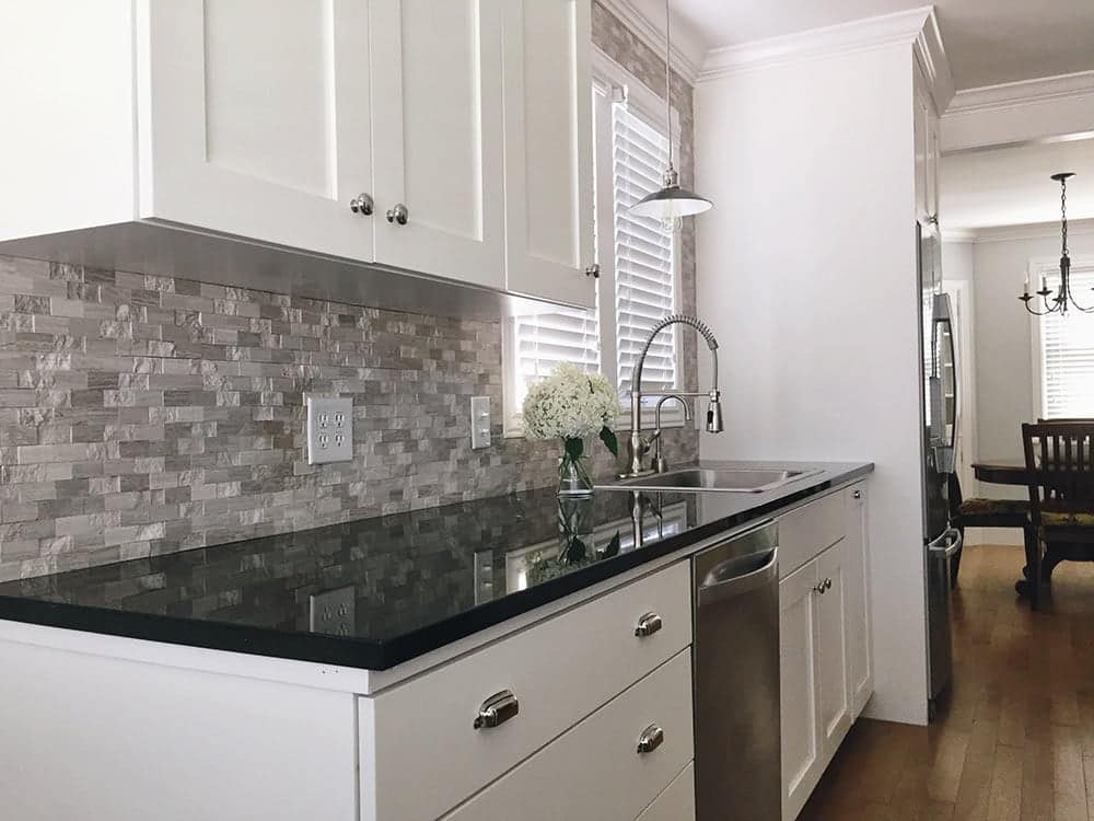 black granite countertop on white cabinets