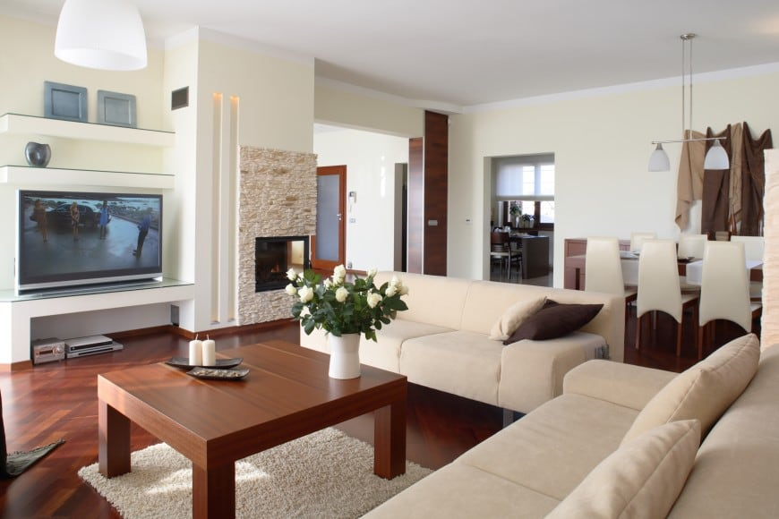 This design, on the other hand, is set in lighter shades that make the whole room look more open and spacious.