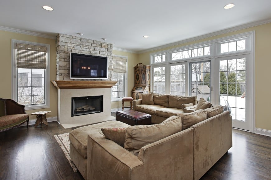 This living room has a beautiful hardwood floor and plenty of windows that open it up to its surrounding area.