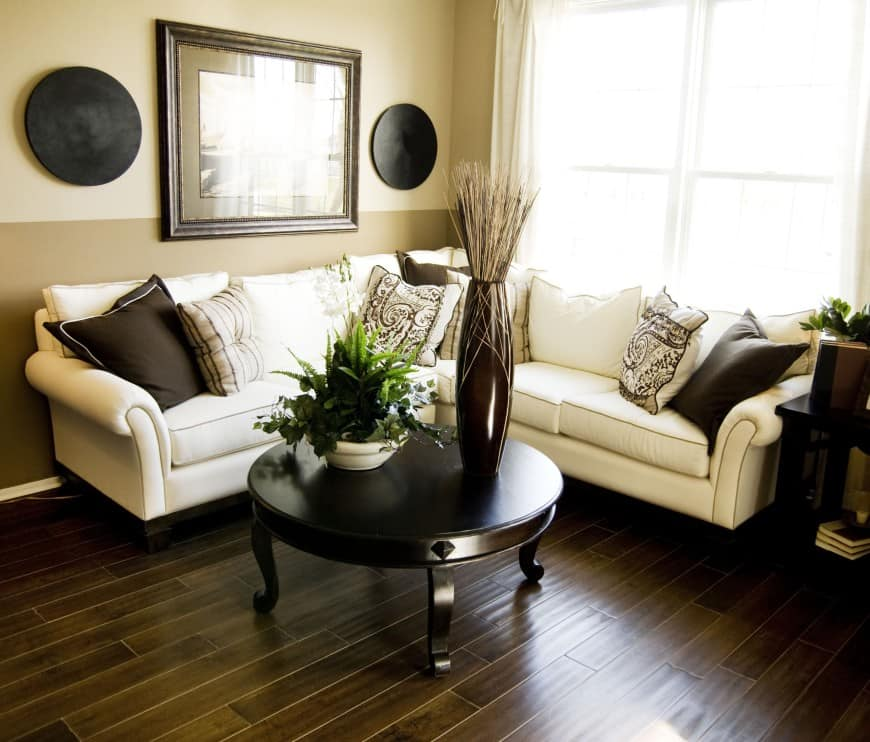 This cozy living room in brown and beige has a traditional appeal