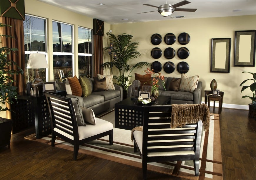 This living room design set in brown and beige looks cozy and inviting