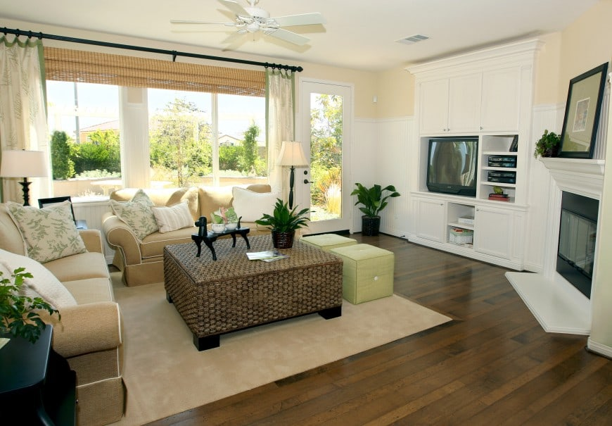 - This cozy living room has hardwood floors and large windows.