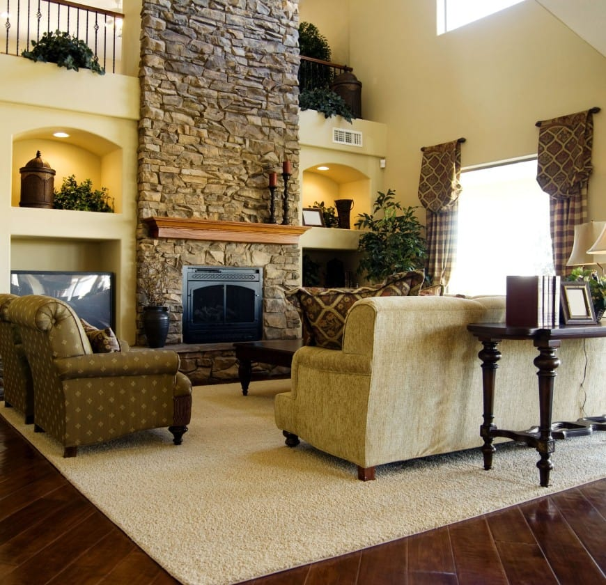 Here is a traditional living room design set in wood and stone.
