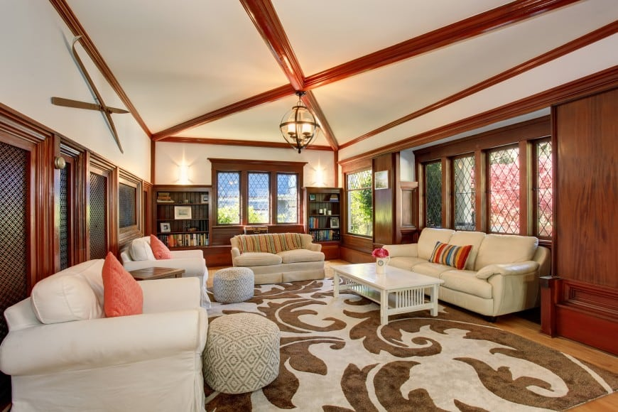 Here is a more traditional living room design. It is set in red wood and contrasting beige