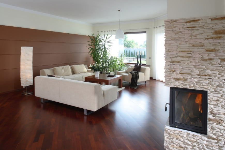 It features a diagonal hardwood floor, wall panelling and stone cladding