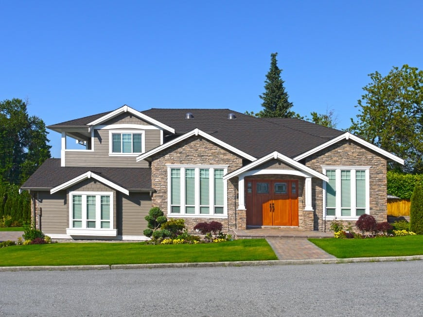 large house with a beautiful front lawn