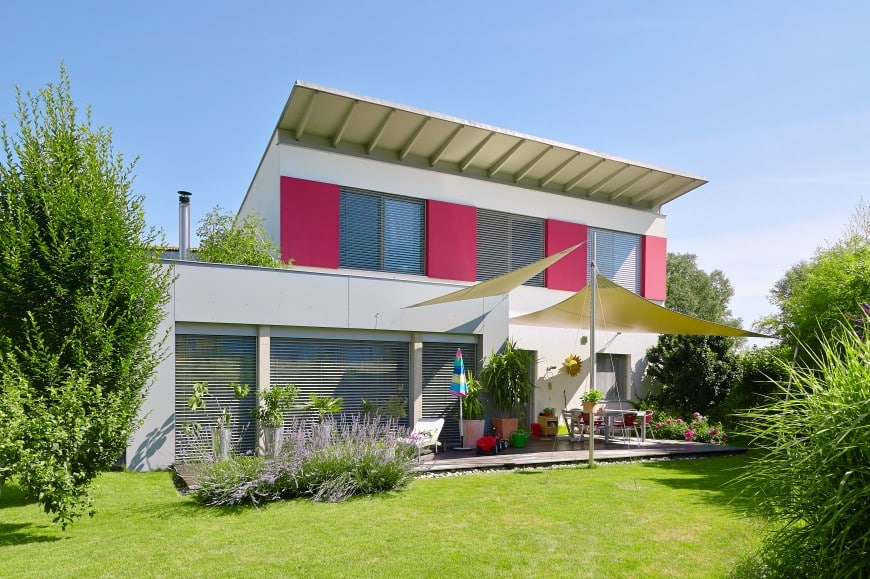 modern house painted white with a color burst in magenta.