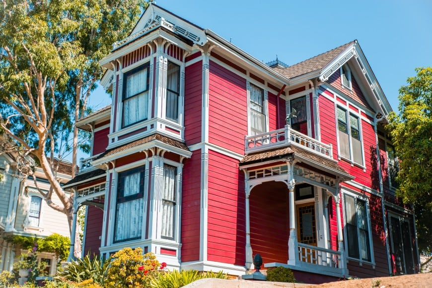 This Victorian house has a bold exterior set in red with details in white