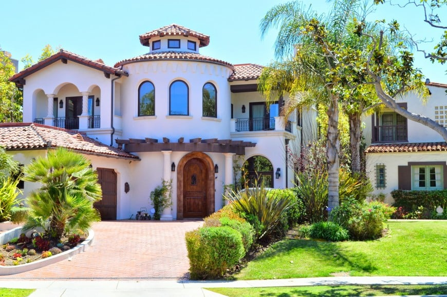 This Spanish Colonial style house has a white stucco exterior